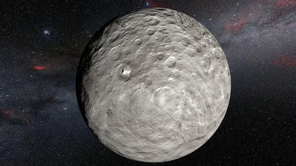 Foto: Ilustración de Ceres a partir de las imágenes captadas por la sonda Dawn de la NASA. Los puntos brillantes se observan en el cráter Occator y en otros lugares del planeta enano. (ESO)