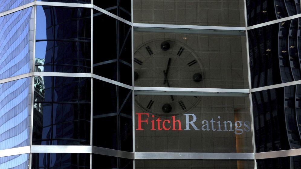 Foto: La bofetada de Fitch se salda con un tono agridulce en Liberbank, Popular y Bankia