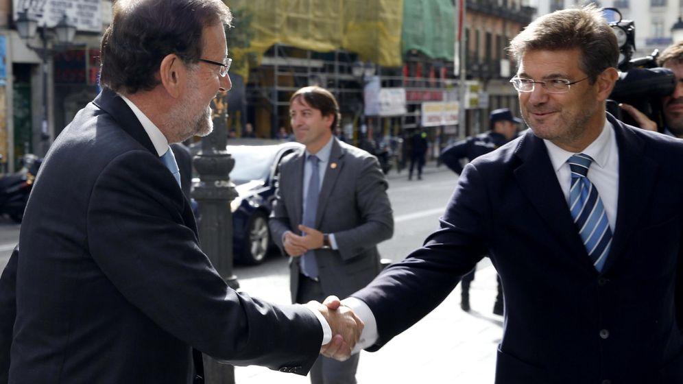 Foto: El presidente del Gobierno, Mariano Rajoy, y el ministro de Justicia, Rafael Catalá. (EFE)