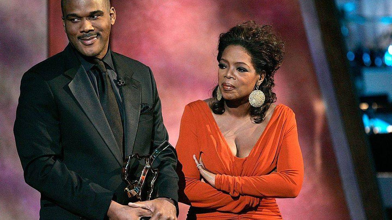 El director, con Oprah Winfrey. (Getty)