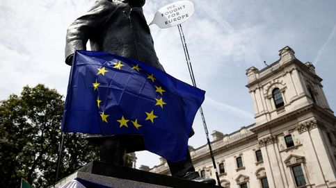 An eu flag is draped across the statue of winston chruchill in parliament square, as eu supporters, calling on the government to give britons a vote on the final brexit deal, participate in the 'people's vote' march in central london