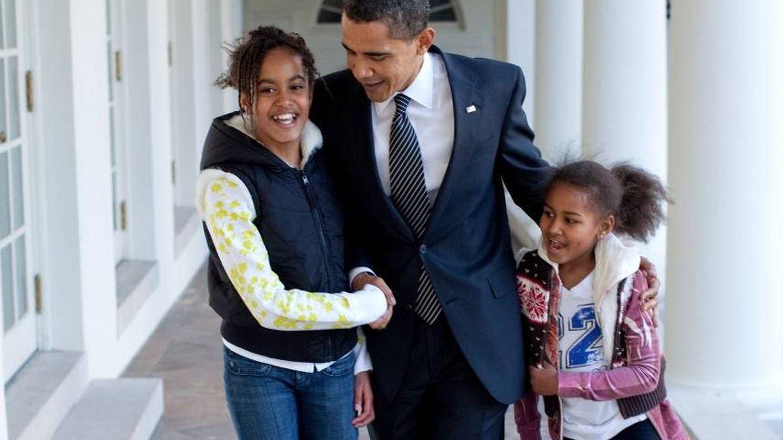 Obama y sus hijas.