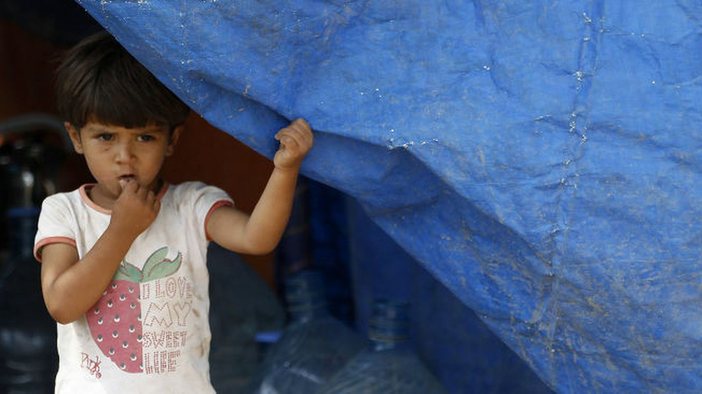 Una niña siria refugiada en el campamento de Domiz, en la provincia iraquí de Dohuk (Reuters).