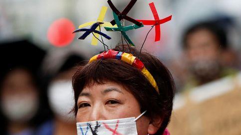 Diadema y mascarilla contra los Juegos Olímpicos