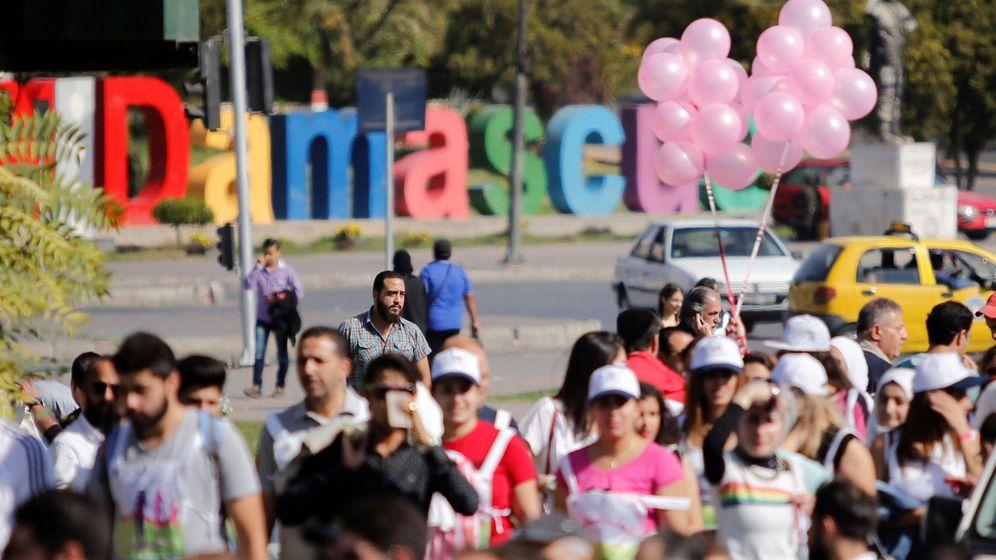 Foto: Ciudadanos tomar parte en un maratón contra el cáncer de mama en Damasco el 27 de octubre (Reuters)