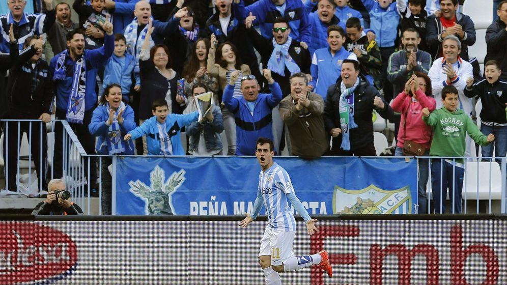 Foto: Juanmi celebra uno de los goles del Málaga frente al Córdoba.