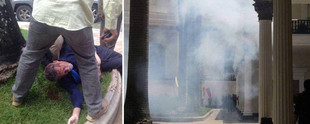 Foto: El diputado Americo de Grazia tendido en el suelo tras el asalto.