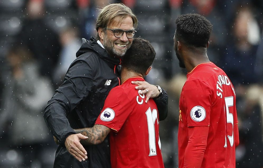 Foto: Liverpool manager juergen klopp celebrates with philippe coutinho and daniel sturridge at the end of the match