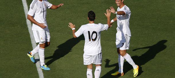 Foto: Cristiano, Khedira y Özil celebran un golo en Los Ángeles (Efe).