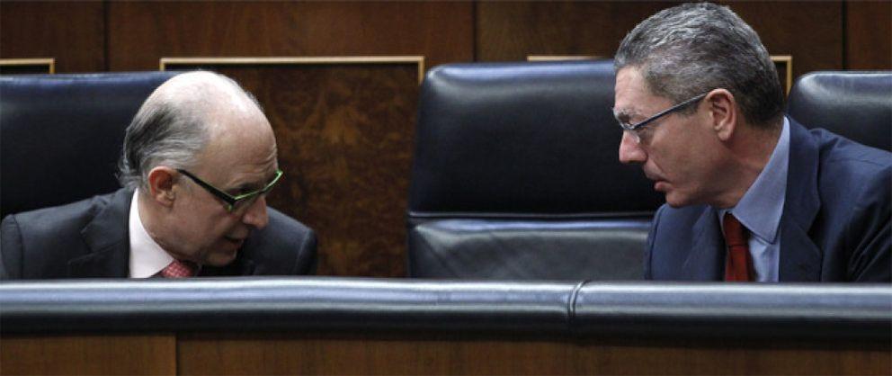 Foto: La descoordinación entre Gallardón y Montoro cuesta casi un millón al día en tasas judiciales