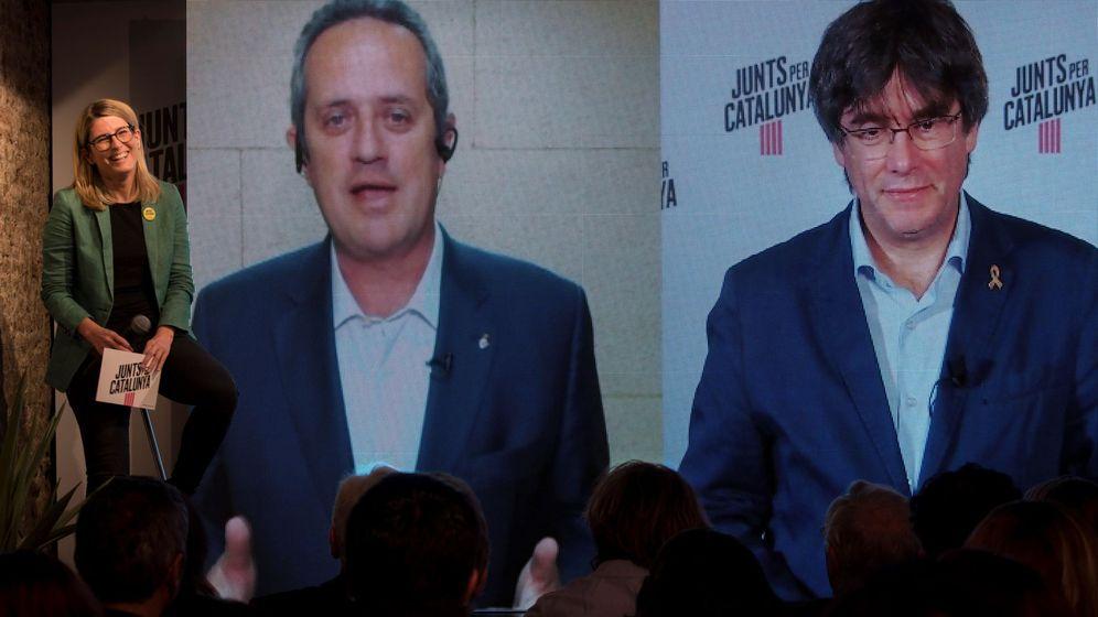 Foto: El cartel de JxCat en las europeas, Carles Puigdemont (d), y el alcaldable de Barcelona, Joaquim Forn (i), durante un acto electoral celebrado de JxCat (Efe)