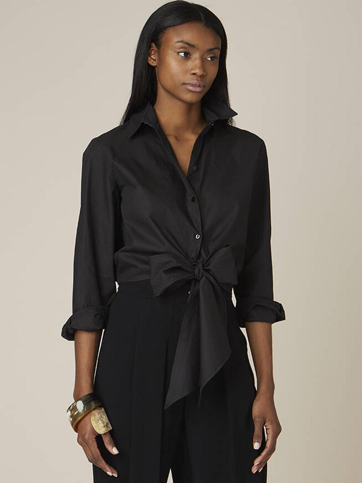 La blusa negra de Tot-Hom.