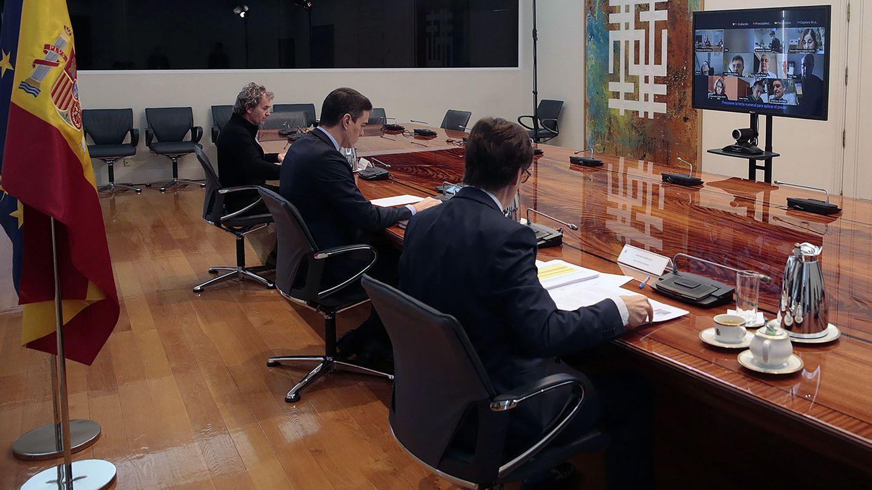 Fernando Simón, Pedro Sánchez y Salvador Illa. (Reuters)