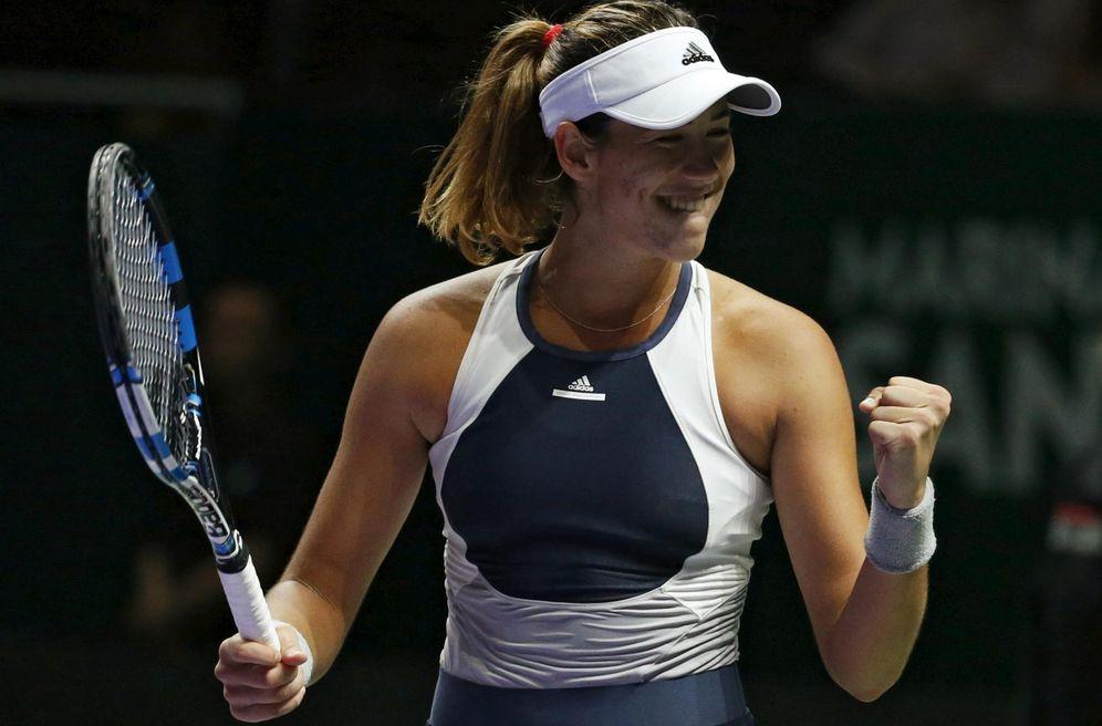 Foto: Garbiñe Muguruza celebra su victoria ante Lucie Safarova (Efe).