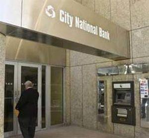 El banco americano de Caja Madrid pierde 185 millones tras un saneamiento brutal