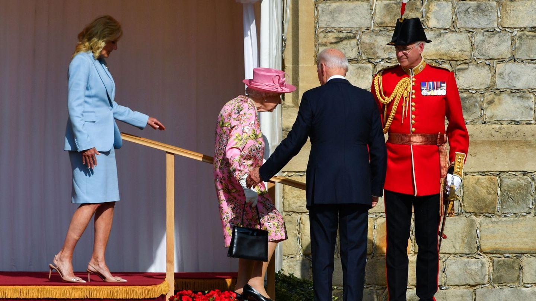 U.S. President Joe Biden stands as first lady Jill Biden and Britain's Queen Elizabeth walk, at Windsor Castle in Windsor, Britain, June 13, 2021. REUTERS Dylan Martinez