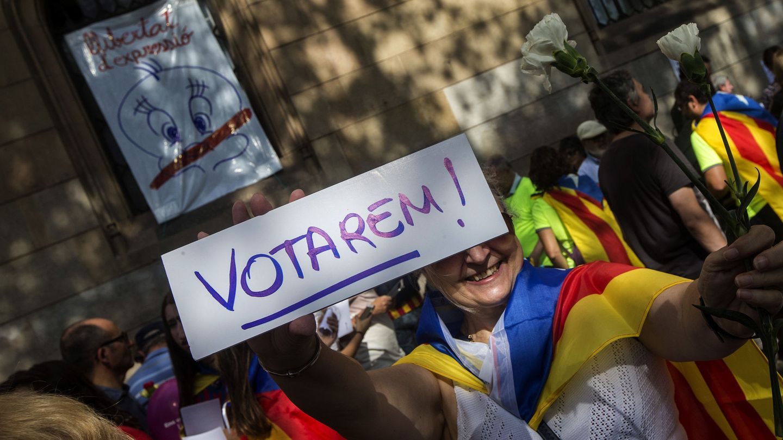 Manifestantes a favor del referéndum de este domingo. (EFE)