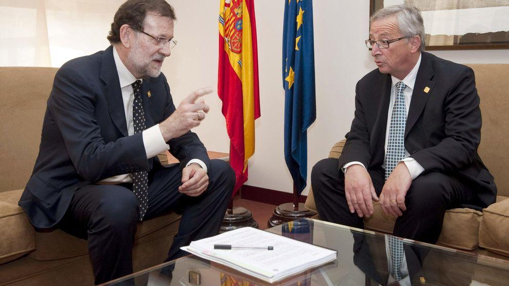 Guindos y Rajoy encabezan la defensa de la banca contra Bruselas