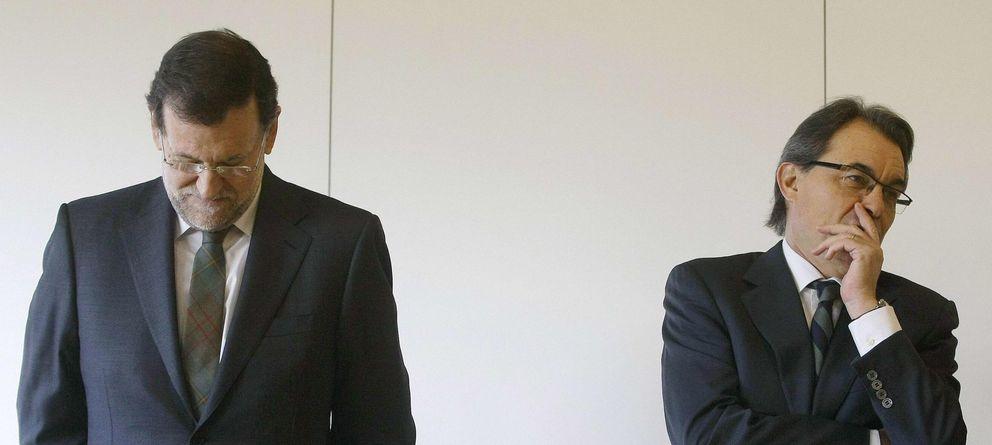 Foto: Mariano Rajoy y Artur Mas, en la inauguración del tramo de AVE Barcelona-Figueras, en 2013. (Reuters)
