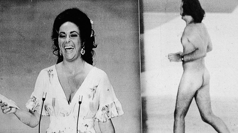 Liz Taylor se ríe ante la presencia del hombre desnudo. (Getty)