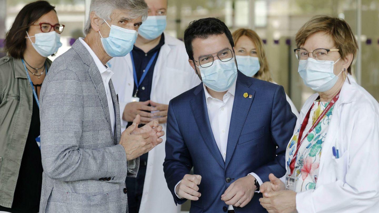 El presidente de la Generalitat, Pere Aragonés y el conseller de Salud, Argimon. (EFE)