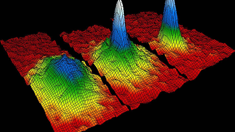 Representación del condensado de Bose-Einstein, estado de agregación de la materia que se da en ciertos materiales a temperaturas cercanas al cero absoluto. La coloración indica la cantidad de átomos moviéndose a cada velocidad, donde el blanco y el azul son las velocidades más bajas
