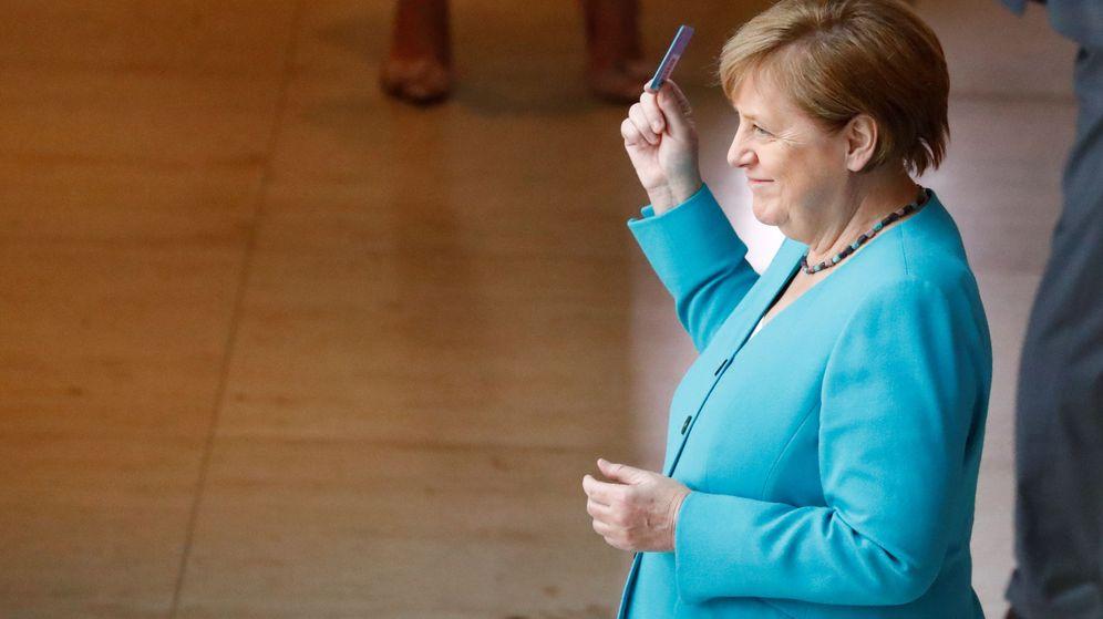 Foto: Angela Merkel antes de votar en el Parlamento alemán. (Reuters)