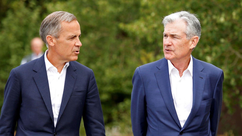 Mark Carney, exgobernador del Banco de Inglaterra, y Jerome Powell, presidente de la Fed. (Reuters)