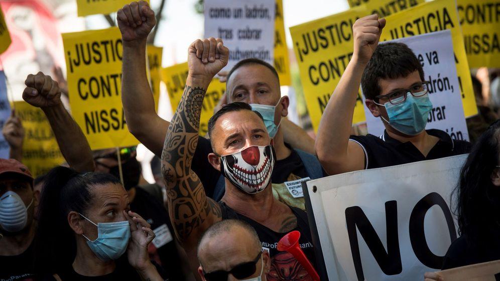 Foto: Trabajadores de las plantas barcelonesas de Nissan se manifiestan en Madrid en contra del cierre de las fábricas de la compañía en Cataluña. (EFE)