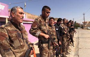 Con los soldados cristianos de Irak: tomar las armas para defender tu tierra