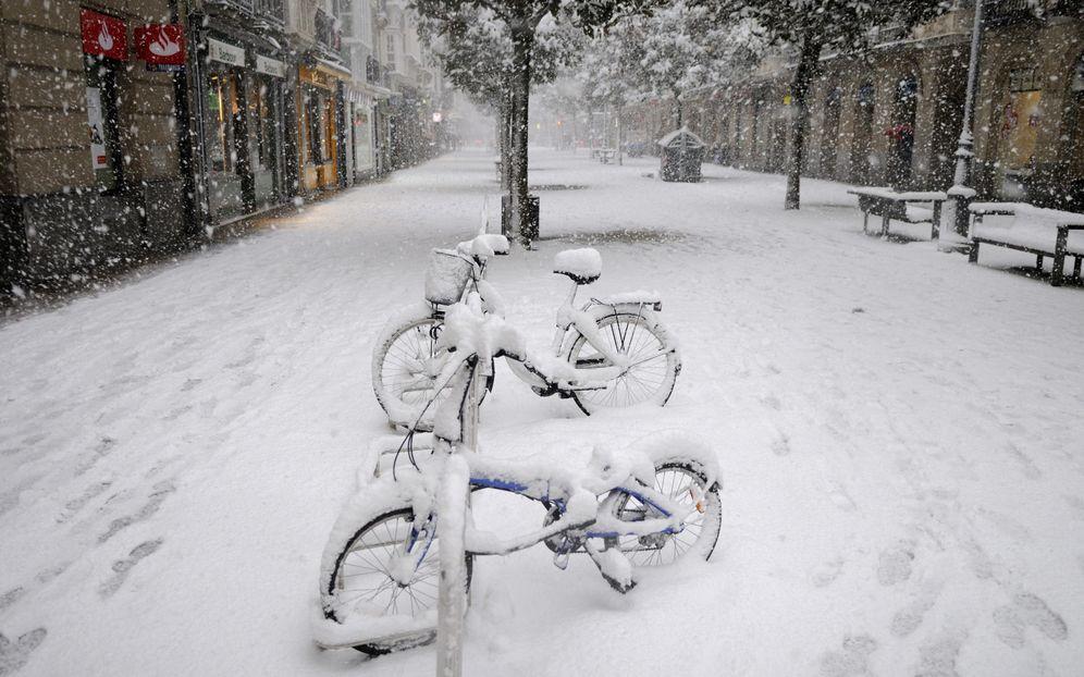 Resultado de imagen de foto de bici con nieve y frio