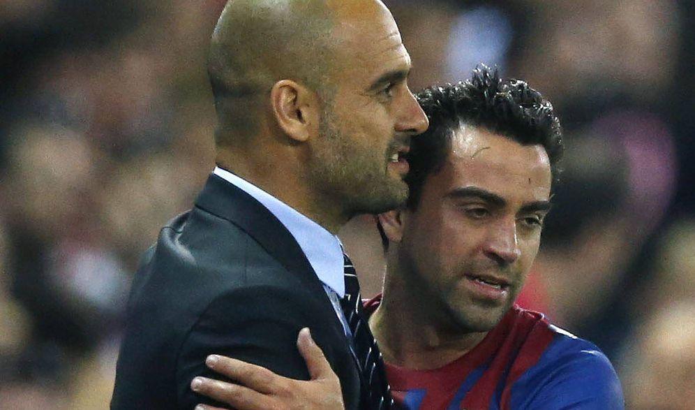 Foto: Josep Guardiola y Xavi Hernández, durante un partido de Liga disputado en 2012. (EFE)