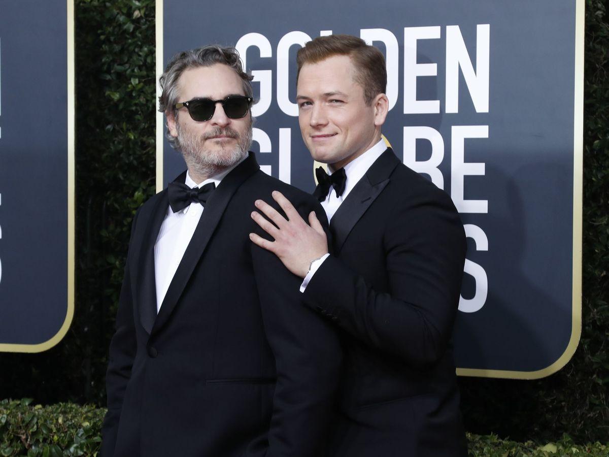 Foto: Joaquin Phoenix y Taron Egerton, dos de los ganadores de la noche. (Reuters)