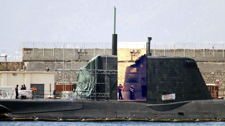 Foto: El submarino de la Royal Navy 'HMS Ambush' de propulsión nuclear británico en el puerto de Gibraltar con una tela verde en la zona afectada en tareas de reparación. (EFE)