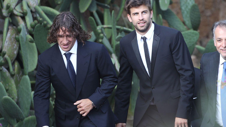 Gerard Piqué y Carles Puyol en una fotografía de archivo. (Gtres)