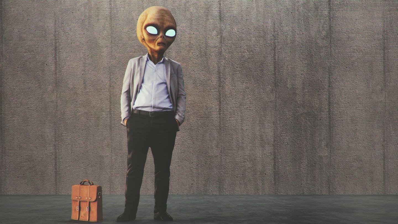 Alien businessman waiting on the street.