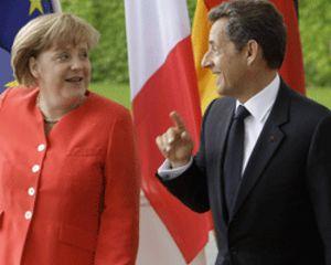 Merkel y Sarkozy acuerdan la participación voluntaria de los acreedores privados en la crisis griega