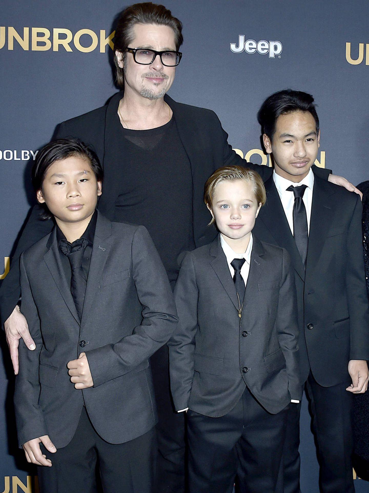 Brad Pitt, junto a Pax, Shiloh y Maddox. (Getty)