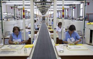 La 'receta del FMI' para España: 14 euros por cada hora de trabajo