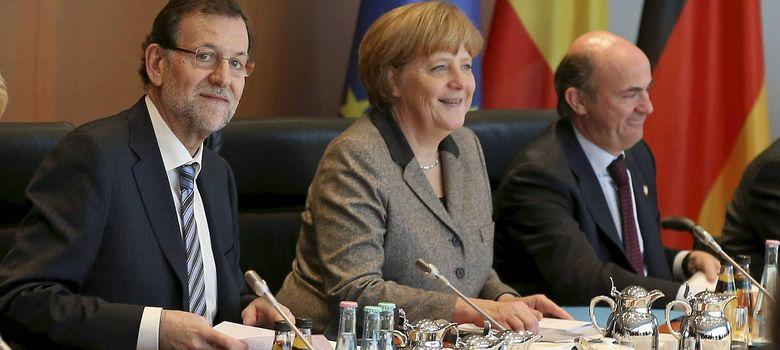 Foto: Angela Merkel, Mariano Rajoy y Luis de Guindos (EFE)