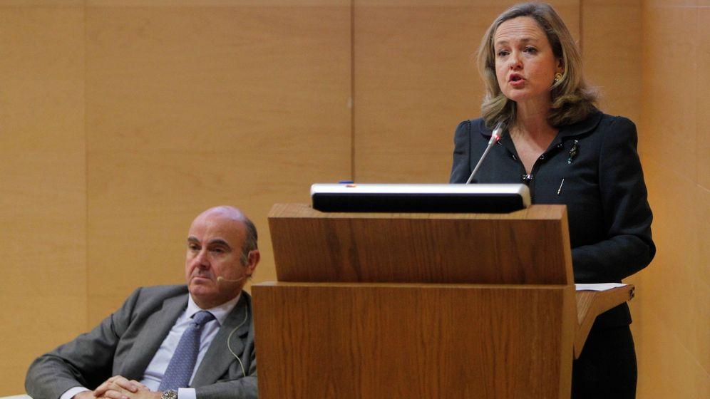 Foto: El exministro Luis de Guindos y la ministra de Economía, Nadia Calviño, en una foto de archivo. (EFE)