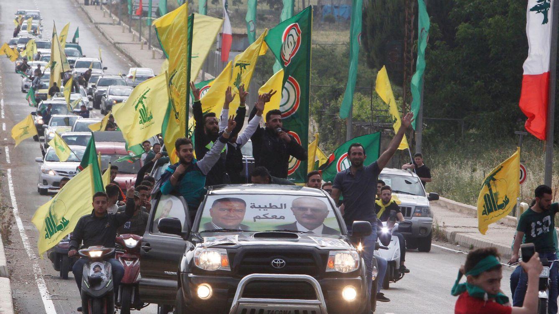 Foto: Miembros y partidarios de Hezbolá y Amal celebran su victoria en Marjayún, al sur del Líbano, el 7 de mayo de 2018. (Reuters)