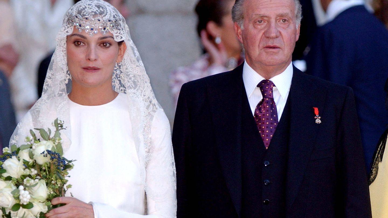 Laura Ponte, con la tiara y junto al rey Juan Carlos. (Getty)