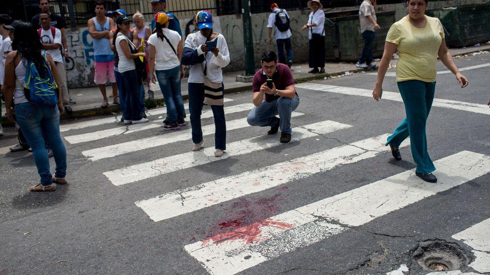 Foto: Opositores venezolanos se enfrentan a la policía en Caracas