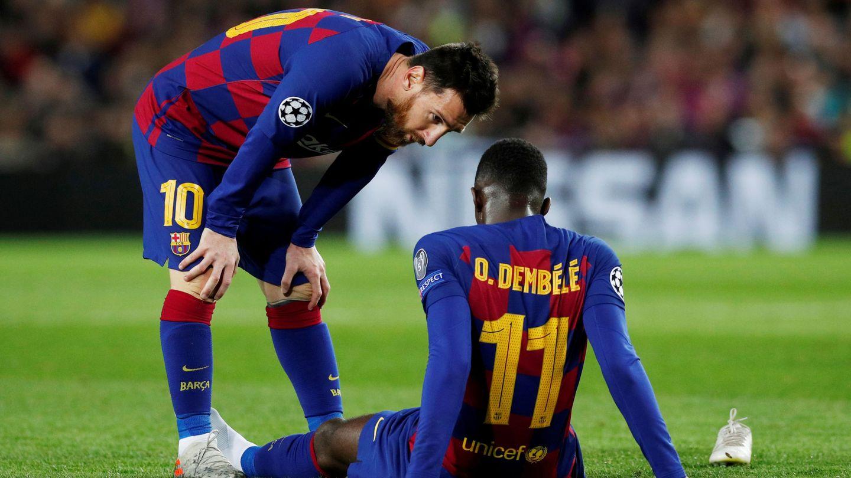 Messi, junto a Dembèlè el día de su lesión en el Camp Nou. (EFE)