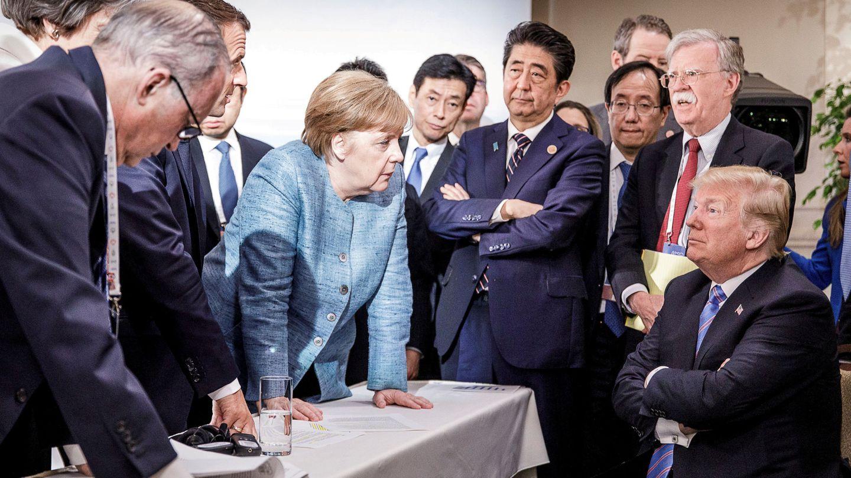 Merkel y Trump, en la cumbre del G-7 de 2018. (Reuters)