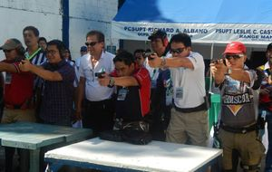Reporteros que ejercen con pistola