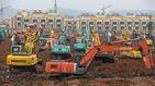 China construye a contrarreloj un hospital para tratar a los afectados por el virus