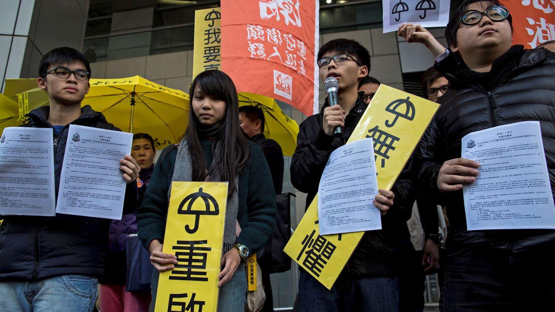 Oscar Lai, Agnes Chow, Joshua Wong and Derek en 2015. (Reuters)