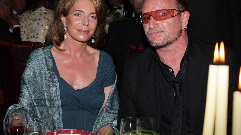 Con Bono, cantante de U2, en una cena benéfica. (Getty)